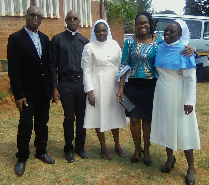 Tsitsi with Father Kunaka,Father Chasarir, Sister Kudzi and Sister Ottilia.. First Profession LCBL Convent... Harare